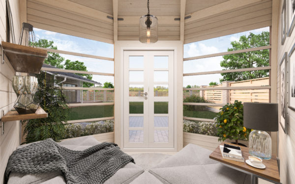 View from the interior of the Crown Compact wooden garden house. Showing Seating, shelving and view of a garden.