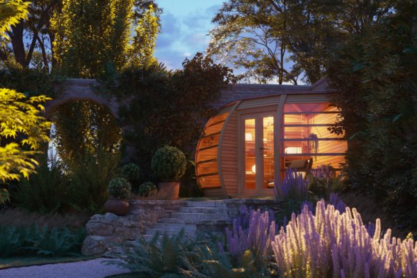 Picture of the Crown Compant garden house at night. Illimunated to showcase how eye-catching a design this wooden house is.